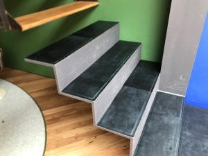 Leather stairs covering tundra off black